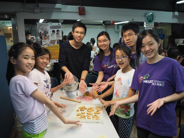 Connect ACE baking cookies with the children